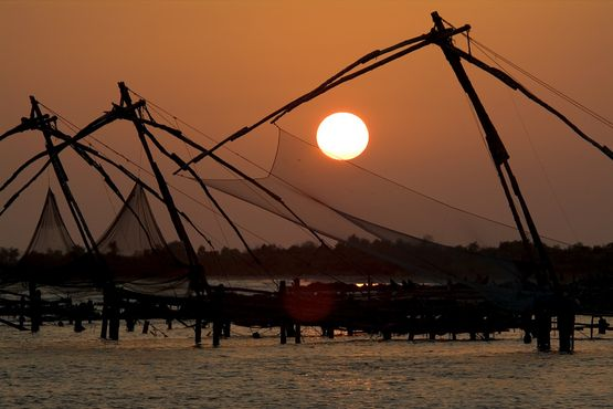 Cochin Pier At Sunset - India